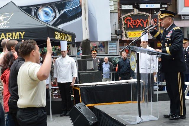 Gen. John Campbell, vice chief of staff of the Army, administers the oath of enlistment to 31 new recruits during the 238th Army Birthday celebration in Times Square, New York City, June 14, 2013.