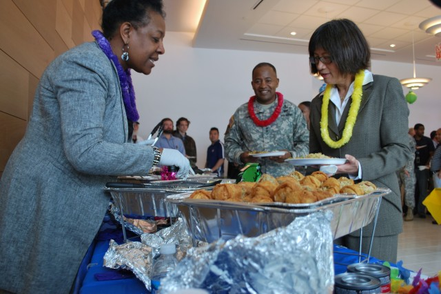 Sheryl Coleman, ARL, serves food to the Honorable Heidi Shyu, Assistant Secretary of the Army for Acquisition, Logistics and Technology who was guest speaker at APG's Asian American and Pacific Islander Heritage Month ceremony. Also shown is Maj. Gen. Robert Ferrell, commanding general, Communications-Electronics Command.
