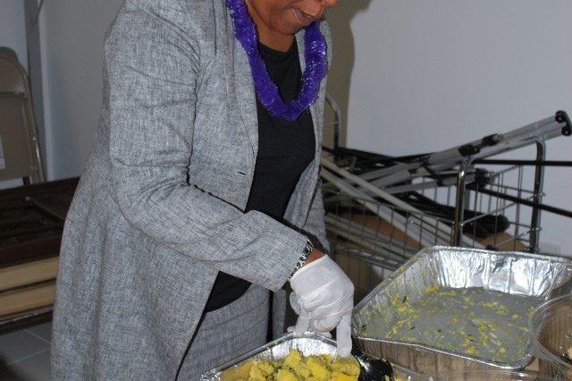 Shown is Sheryl Coleman, ARL, preparing some of the food that was sampled at APG's Asian American and Pacific Islander Heritage Month ceremony that was held at the Myer Auditorium, May 20.