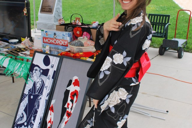 "Shown is Shauna Mintz, from ARL's Vehicle Technology Directorate, who wore a modern summer kimono (YUKATA) during APG's Asian American and Pacific Islander Heritage Month ceremony. Mintz hosted the ""Japan Table."""