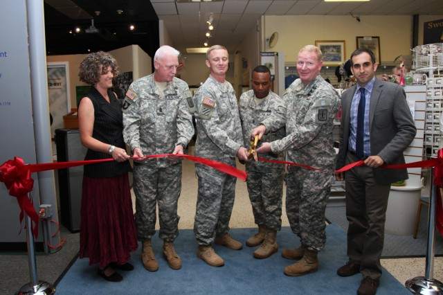 Brig. Gen. John E. O'Neil IV, Quartermaster General and commandant of the Quartermaster School, second from the right, and Col. John F. Haley, Chief of Ordnance and commandant of the Ordnance School, third from left, cut the ribbon to officially open a new ordnance exhibit in the Quartermaster Museum June 17. Joining the official party from left to right - Claire Samuelson, Ordnance Museum director; Ordnance Regimental Command Sgt. Maj. Clinton G. Hall; Quartermaster Regimental Command Sgt. Maj. Spencer L. Gray and Paul Morando, Quartermaster Museum director.
