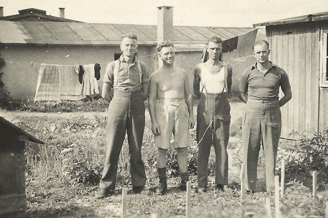 Sgt. Frederick Foster (left) poses with fellow POWs in Stalag 383 in what is now the Hohenfels training area.