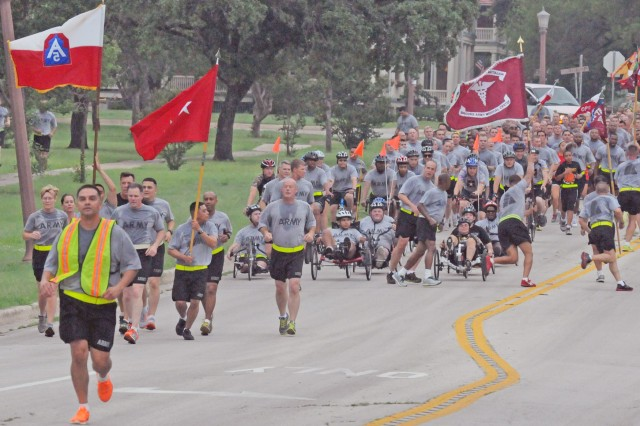 FORT SAM HOUSTON, Texas - U.S. Army North (Fifth Army) leads the Fort Sam Houston Army team as they demonstrate their resiliency during the 'Thunder Run' June 14 as part of the celebration of the Army's 238th Birthday. The run began and ended at the historic Quadrangle and included a cake-cutting before it started.