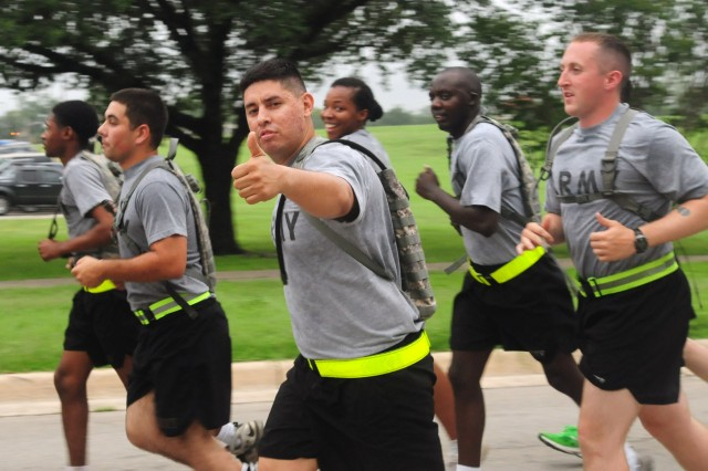 FORT SAM HOUSTON, Texas - A Soldier gives a thumbs-up as he runs down the final leg of the 'Thunder Run' June 14 as part of the U.S. Army North-led celebration of the Army's 238th Birthday. The Fort Sam Houston Army team demonstrated their teamwork and professionalism as they came together for the run, which began and ended in the historic Quadrangle.