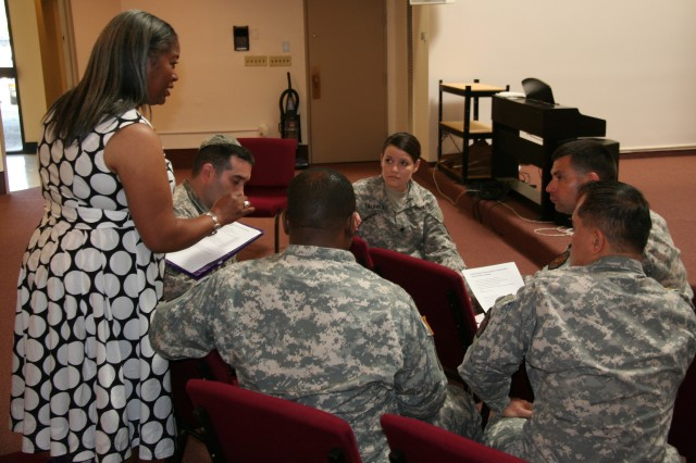Fort Stewart Family Advocacy Specialist Eldotha Fields addresses attendees of a Installation Family Life Chaplain training at Victory Chapel, June 13 on Fort Stewart, regarding SHARP, Domestic Violence and Child Abuse.