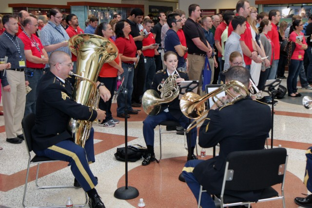 "SAN ANTONIO - Members of the ""Cat 5"" brass ensemble, made up of members of the 323rd Army Band ""Fort Sam's Own,"" play traditional patriotic songs June 14 while employees and guests gather for the 238th Army Birthday Celebration at USAA headquarters in San Antonio."