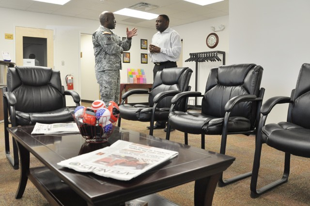 From left, Garrison Command Sgt. Maj. James Ervin and Alcohol and Drug Control Officer Timothy Knox chat in the new reception area of the Army Substance Abuse Program facility in Bldg. 2477 during its open house June 5.