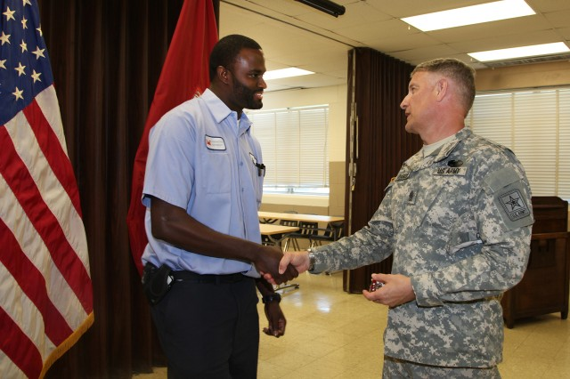 (l to r) Daaniyal Mcgill, Distribution and Electrical Section, Maintenance Branch, receives a coin for his outstanding service from Sgt. Maj. of the Army Raymond F. Chandler. SMA Chandler visited the U.S. Army Corps of Engineers Washington Aqueduct to learn more about the Corps unique and diverse mission, June 5, 2013.