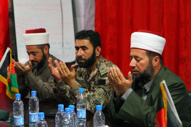 """KHOWST PROVINCE, Afghanistan """" Maj. Abdel Latif alongside Imams Capt. Imam Sabri Al Qudah and Lt. Imam Ahmad Shemayli, with the Jordanian Engagement Team based out of Bagram Airfield, Afghanistan, pray during a meeting, June 11, 2013, in Khowst Province, Afghanistan. (U.S. Army photo Sgt. Justin Moeller, 4th Brigade Combat Team Public Affairs)"""