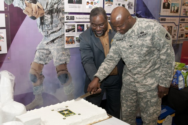 Danny Miles, ALC director of Army Community Services, and Col. John Shanklin, U.S. Army Research Laboratory military deputy, cut the cake June. 13 to celebrate the Army's 238th Birthday.