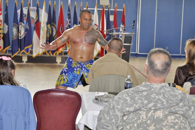Sgt. 1st Class Burgie Perofeta dances during the Asian American and Pacific Islander Heritage Month Celebration in Wiesbaden.