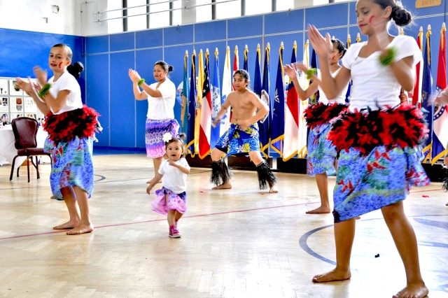 Camryne San Miguel, 15 months old, dances with fellow Samoan dancers during the Wiesbaden military community 2013 Asian American and Pacific Islander Heritage Month Celebration.