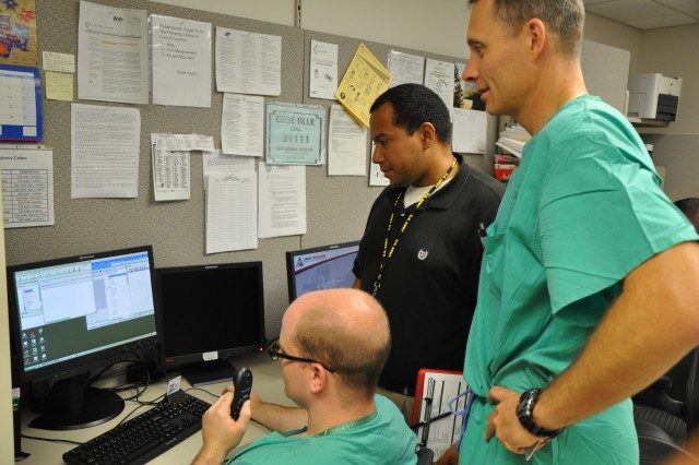 Rafael Santiago (middle), BAMC Information Technology specialist instructs Army Cpt. Gregory Kelts, Otolaryngology resident, the new program on the Viosk system as Army Lt. Col. Peter O'Connor, Otolaryngology-Head & Neck Surgeon, Sleep Medicine Physician looks on. Currently, there are more than 550 BAMC Viosks throughout the medical center with a goal to replace all standard desktops with Viosk in the near future.