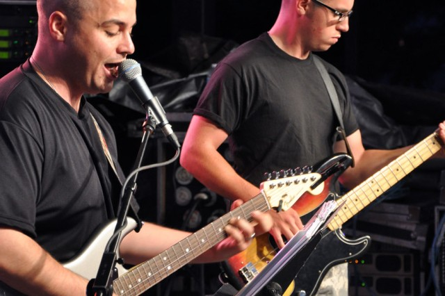 94th Army Band guitarists, Sgt. Mark Bilotta, left, and Spc. Alexander Bowyer were part of the second rock band from the 94th Army Band, which closed the show.