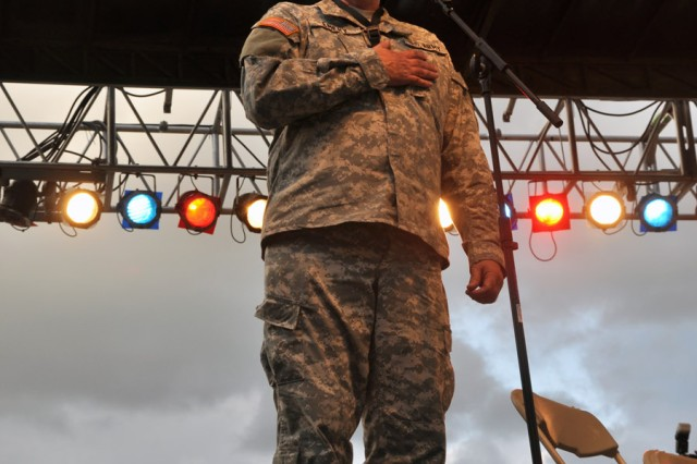 Chief Warrent Officer 3 Charles Emery, 94th Army Band commander, singing during the first song set.
