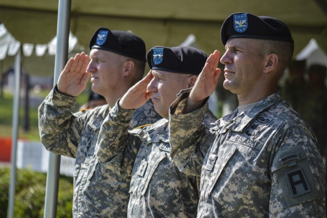 Col. Dale Kuehl, outgoing commander of the 177th AR Bde, Maj. Gen. Kevin R. Wendel, commanding general of First Army Division East, and Col. William Chlebowski, incoming 177th AR Bde commander salute during the National Anthem during a change of command ceremony held at at Camp Shelby Joint Force Training Center. (U.S. Army photo by Spc. Karen Sampson, 177th Armored Brigade Public Affairs)