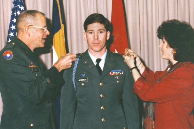 "McGuiness was assigned to Picatinny Arsenal, his first posting as an acquisition officer, when he was promoted to major in January 1995. He is being ""pinned"" by Brig. Gen. James W. Boddie, Jr., and his wife, Gail. Courtesy photo."