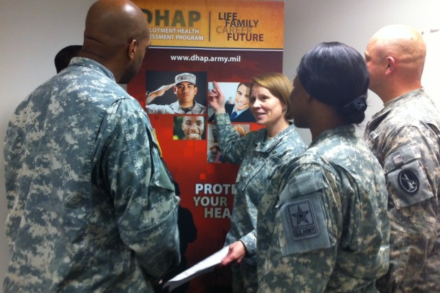 Maj. Christine Ludwig, Program Executive Officer, Deployment Health Assessment Program, answers questions from Soldiers about the Deployment Health Assessments.
