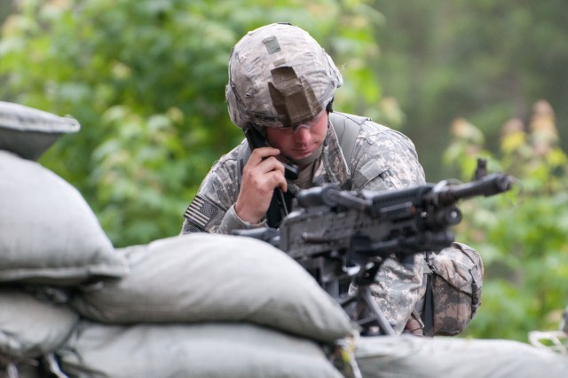Sgt. 1st Class Matthew S. Weise, an infantryman with the 82nd Airborne Division's 1st Brigade Combat Team, uses a radio during Expert Infantryman Badge testing on the traffic control point lane, June 11, 2013, at Fort Bragg, N.C. Weise, a native of Stone Mountain, Ga., was one of 486 candidates who vied for the coveted badge, June 9-13. (U.S. Army photo by Staff Sgt. Mary S. Katzenberger)