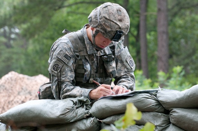 Sgt. Cody T. Garcia, an infantryman with the 82nd Airborne Division's 1st Brigade Combat Team, uses a protractor and map during Expert Infantryman Badge testing on the traffic control point lane, June 11, 2013, at Fort Bragg, N.C. Garcia, a Sacramento, Calif., native, was one of 486 candidates who vied for the coveted badge, June 9-13. (U.S. Army photo by Staff Sgt. Mary S. Katzenberger)