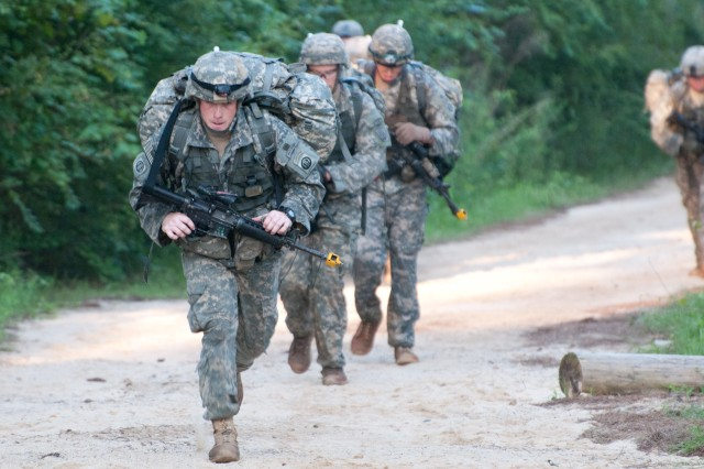 Infantrymen with the 82nd Airborne Division's 1st Brigade Combat Team complete a 12-mile foot march in less than three hours during the final stage of Expert Infantryman Badge testing, June 13, 2013, at Fort Bragg, N.C. Forty-two candidates, each carrying up to 70 pounds of gear, completed the forced march to earn the coveted badge. (U.S. Army photo by Staff Sgt. Mary S. Katzenberger)