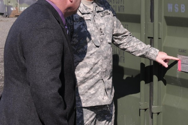 Bernard Olszewski, manager of the Army Reserve's Equipment Concentration Site 99, left, and Master Sgt. William Kaye, Army Reserve Command, inspect a medical CONEX March 14 at the Medical Storage and Maintenance Facility located inside ECS 99 on Joint Base McGuire-Dix-Lakehurst, N.J. This 60,000-square-foot, solar-powered, climate-controlled facility provides the 3rd Medical Deployment Support Command storage space for medical, dental, veterinary, forward surgical and early entry hospital equipment, as well as maintenance capabilities for bio-medical equipment and x-ray, ventilator and defibrillator repair.