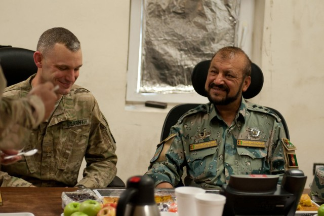 U.S. Army Maj. Michael O'Meara, brigade intelligence/S2 officer, 1st Brigade Combat Team, 101st Airborne Division, of Clarksville, Tenn., and Col. Muhammad Sadiq, director of intelligence, Afghan Border Police, laugh together during their initial meeting at the ABP Zone 1 compound in Jalalabad, Nangarhar province, Afghanistan, June 10, 2013. This meeting marks the first time U.S. Army intelligence personnel have met face-to-face with their Afghan counterparts in Zone 1 to trade notes on securing the Nuristan-Kunar-Nangarhar region. (U.S. Army photo by Sgt. Margaret Taylor, 129th Mobile Public Affairs Detachment)
