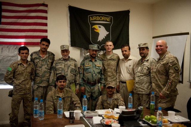 Officials from the Afghan Border Police, the Afghan Department of Intelligence and the Afghan National Civil Order Police pose with U.S. Army soldiers from the Security Forces Advisory and Assistance Team-ABP Zone 1, 1st Brigade Combat Team, 101st Airborne Division, and the brigade intelligence office, 1st BCT, 101st Airborne Division, at the ABP Zone 1 compound in Jalalabad, Nangarhar province, Afghanistan, June 10, 2013. This meeting marks the first time U.S. Army intelligence personnel have met face-to-face with their Afghan counterparts in Zone 1 to trade notes on securing the Nuristan-Kunar-Nangarhar region. (U.S. Army photo by Sgt. Margaret Taylor, 129th Mobile Public Affairs Detachment)