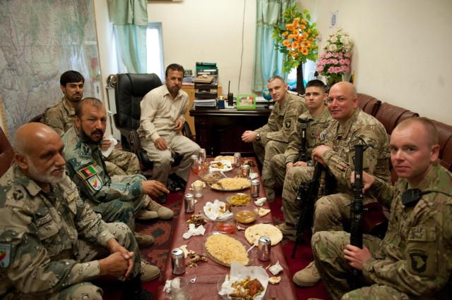 Officials from the Afghan Border Police and the Afghan Department of Intelligence dine with U.S. Army soldiers from the Security Forces Advisory and Assistance Team ABP Zone 1, 1st Brigade Combat Team, 101st Airborne Division, and the brigade intelligence office, 1st BCT, 101st Airborne Division, at the ABP Zone 1 compound in Jalalabad, Nangarhar province, Afghanistan, June 10, 2013. This meeting marks the first time U.S. Army intelligence personnel have met face-to-face with their Afghan counterparts in Zone 1 to trade notes on securing the Nuristan-Kunar-Nangarhar region. (U.S. Army photo by Sgt. Margaret Taylor, 129th Mobile Public Affairs Detachment)