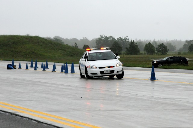Guardian Academy students maneuver through an obstacle course at speeds reaching roughly 45 mph during a driving course at Wheeler-Sack Army Airfield on June 11. The military police Soldiers were met with rainy and slick driving conditions, making the training slightly more difficult.