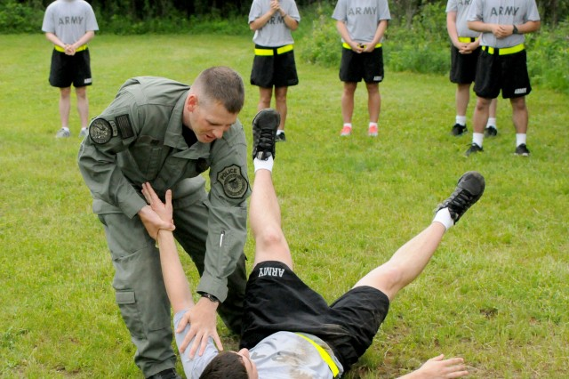 Sgt. Justin Richardson shows 24 Guardian Academy students a submission technique during a class June 3. All military police Soldiers who are new to post must complete the Guardian Academy, also known as the Military Police Certification Course, to learn about procedures specific to Fort Drum and New York state, and to brush up on skills.