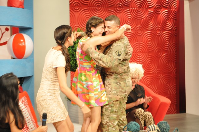 Sgt. Ramon Cano, assigned to the 393rd Combat Sustainment Support Command, US Army Reserve-Puerto Rico, surprised his three daughters by unexpectedly appearing in a live TV program, where his family was participating, June 19.Cano secretly returned to Puerto Rico after spending over 16 months away from his family. He collaborated with his wife Silma Soto to pull off the surprise.