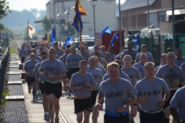 A group of Soldiers gets closer and closer to the finish line at Katterbach Kaserne as part of the five-kilometer Run for the Fallen, which was held in conjunction with Army birthday activities. Soldiers participated in the run to honor their fallen comrades.