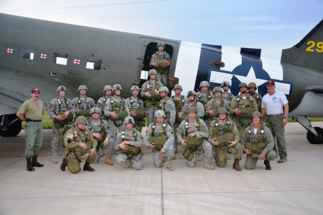 428th Field Artillery Brigade and Ordnance Training Detachment Soldiers from Fort Sill pose for a photo before their parachute jump with the World War II Airborne Demonstration Team of Frederick, Okla.