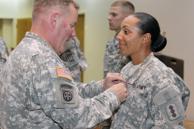 Maj. Gen. Mark McDonald, Fires Center of Excellence and Fort Sill commanding general, pins a medal on Sgt. Queen Ross, noncommissioned officer of the quarter from A Battery, 1st Battalion, 79th Field Artillery, during the quarterly awards luncheon June 13 at the Patriot Club here.