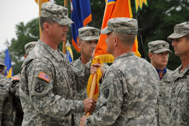 Col. Shawn Prickett accepts the 1st Aviation Brigade colors from Maj. Gen. Kevin W. Mangum, USAACE commanding general, during the unit's change of command ceremony June 14 at Howze Field.