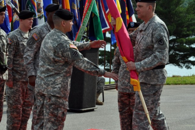 "Col. Robert ""Joe"" Dixon, Jr takes the Crane Army flag from Joint Munitions Command Commanding General Brig. Gen Kevin O'Connell, signifying his acceptance of command of Crane Army Ammunition Activity."