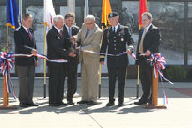 "Kentucky Governor Steve Beshear (second from left) and George Patton ""Pat"" Waters, grandson of Gen. George Patton, cut the ribbon at the rededication ceremony. Maj. Gen. Jeff Smith, commander of U.S. Army Cadet Command and Fort Knox, joined the dignitaries along with Chris Kolakowski, the musem director at the ribbon."