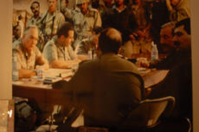 The actual table used by Gen. Norman Schwarzkopf during Operation Desert Shield/Storm sits in front of an exhibit.