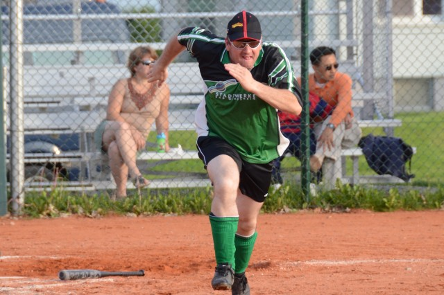 A German softball player takes off toward first after a base hit in the sixth inning of a friendly game June 7 at Katterbach Kaserne.