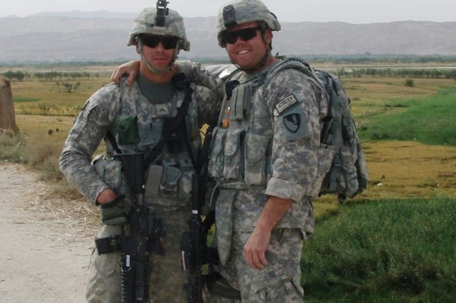 Sgt. Shayne Merritt (right) poses with Sgt. Shane Hawkins while deployed to Afghanistan where Merritt served as a medic and received the Combat Medical Badge for medical aid rendered under enemy fire. (U.S. Army Photo)