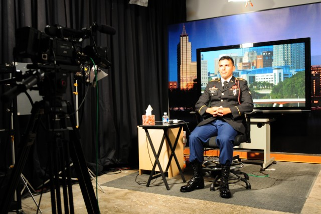 "Spc. Julian Chavez, a forward observer assigned to 2nd Battalion, 319th Airborne Field Artillery Regiment, 2nd Brigade Combat Team, 82nd Airborne Division, conducts a remote, live interview on the ""Fox & Friends"" program from Raleigh, N.C., June 1. Chavez participated in the interview to talk about his personal experiences as a part of the Army's ""Starting Strong"" reality television-based recruiting program."
