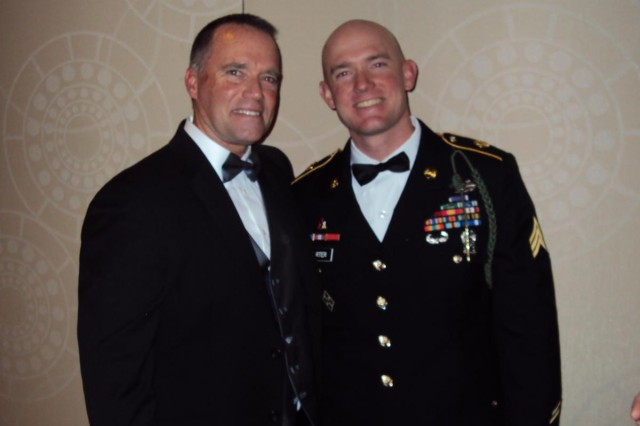 Sgt. Ty M. Carter, a section leader with A Troop, 8th Battalion, 1st Calvary Regiment, 2nd Stryker Brigade Combat Team, 2nd Infantry Division, stands with his father, Mark A. Carter (left), after being awarded the USO's prestigious George Van Cleave Military Leadership Award at the organization's 50th Annual Gala in New York, Dec. 7, 2011.