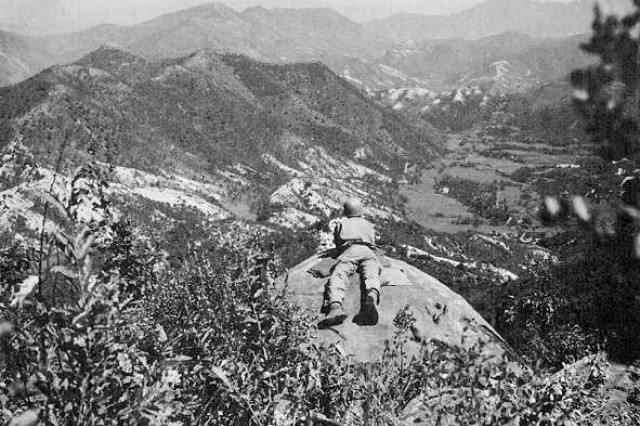 A Soldier from the 1st Cavalry Division, mans an observation post overlooking North Korean-controlled territory on the Pusan Perimeter, in September 1950, the same time and place where Master Sgt. Mike C. Pena and Sgt. Eduardo C. Gomez earned their Medals of Honor.
