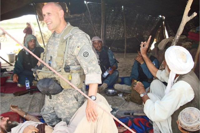 Dr. (Col.) Michael Zapor, a staph infectious diseases physician at Walter Reed National Military Medical Center, treats Afghans during his 2010 tour there as a battalion surgeon with the 82nd Airborne Division. Six years earlier he did similar work in Iraq with the 10th Mountain Division.