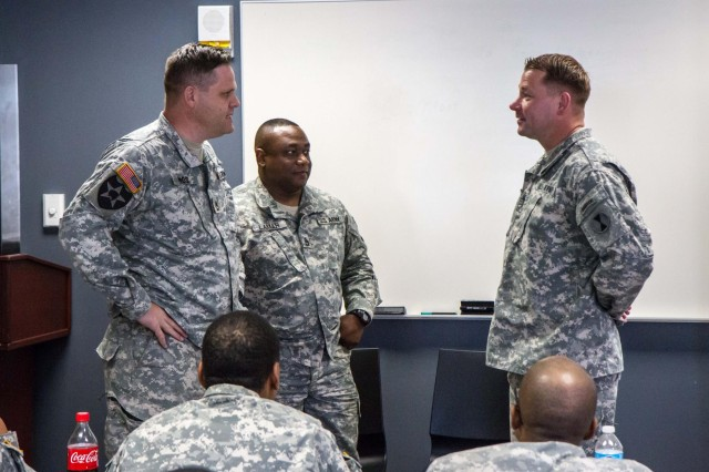 "First Lt. Steven Hunter (right), executive officer for Headquarters Support Company, 7th Infantry Division, plays the role of a female soldier during role playing training for Sexual Harassment/Assault Response and Prevention Stand-Up Day, June 18. For more than 20,000 soldiers, June 18 was a day to take a stand against sexual misconduct, as commanding general, Maj. Gen. Stephen R. Lanza, issued a division-wide sexual harassment and assault stand-up day across seven brigades at Joint Base Lewis-McChord. ""There's five imperatives that you'll see today. The first thing really is about prevention. Establishing the conditions in our organization to prevent this. Second is investigation. Every allegation is professionally investigated by CID. The third and probably most important is to sustain a climate of trust and a command climate that is conducive to dignity and respect in our organizations. The fourth is accountability. Accountability for those who commit these crimes and for the commanders who have to enforce values in these organizations. And then lastly is all leaders engaged,"" explained Lanza."