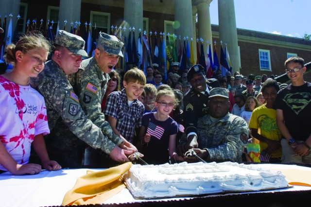 Everyone gathers around for the traditional ceremonial cutting of the cake at the conclusion of the Ft. Belvoir Observance of the 238th Army Birthday & Flag Day at Headquarters Ft. Belvoir US Army Garrison on Friday, June14.