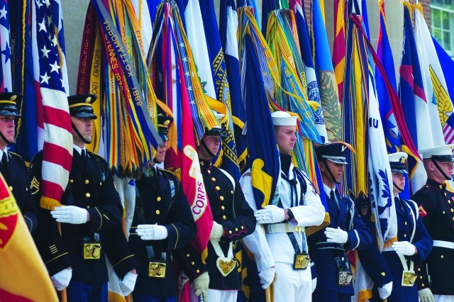 The Joint Services Color Guard stands by during the Ft. Belvoir Observance of the 238th Army Birthday & Flag Day at Headquarters Ft. Belvoir US Army Garrison on Friday, June14.