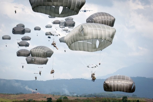 U.S. and Indonesian Army paratroopers exit a C17 Globemaster aircraft, June 18, 2013, during the U.S. Army Pacific-sponsored annual Garuda Shield exercise. This year the jump was held in West Java, Indonesia.  The paratroopers are from the U.S. Army's 82nd Airborne Division, and Indonesian Army 1st Infantry Division. Exercise Garuda Shield is a continuation of ongoing efforts by U.S. Army Pacific to engage with the Tentara Nasional Indonesia.