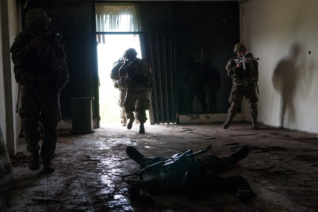 U.S. Army paratroopers with the 82nd Airborne Division's 1st Brigade Combat Team, subdue a roleplaying insurgent during partnered training with the Indonesian Army, June 18, 2013, in West Java, Indonesia.  Exercise Garuda Shield is a continuation of ongoing efforts by U.S. Army Pacific to engage with the Tentara Nasional Indonesia on peace support training capacity and stability operations.